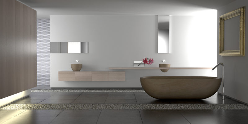 Minimalist white bathroom with stone bathtub and pebbles